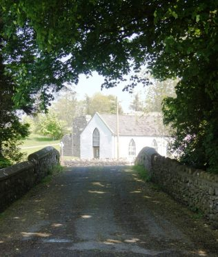 This early 19th century three-arch hump back road bridge over Straide river was bypassed in the early 1980's.  It is  made of local fieldstone offset by limestone dressings.  The bridge is visually attractive and is well  constructed.  It is an important component of the civil engineering heritage of Straide.  A discreet benchmark adds additional interest with its association with the  preparation of Ordnance Survey maps. The bridge leads to the what is now the Michael Davitt Museum, formerly the parish church. | James Larkin